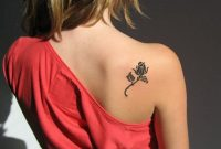 Black Feminine Rose Tattoo On Girl Right Back Shoulder with dimensions 1024 X 780